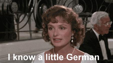 Игра слов.По-английски «I know a little German» можно перевести как «Я немного знаю немецкий» и «Я знаю маленького немца» - Он сидит вон там